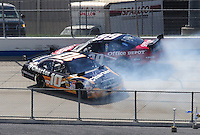 Sept. 21, 2008; Dover, DE, USA; Nascar Sprint Cup Series driver Carl Edwards (99) goes high to avoid a spinning Patrick Carpentier (10) during the Camping World RV 400 at Dover International Speedway. Mandatory Credit: Mark J. Rebilas-