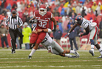 NWA Media/Michael Woods --11/22/2014-- w @NWAMICHAELW...University of Arkansas running back Jonathan Williams is tackled by Ole Miss defender Cody Prewitt in the 1st quarter of Arkansas 30-0 win over Ole Miss during Saturdays game at Razorback Stadium.