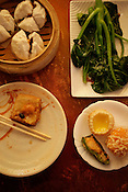 Clockwise from top right, Chinese broccoli with oyster sauce, Hong Kong egg tart, shrimp ball, stuffed green pepper and shrimp, stuffed tofu and shrimp, steamed BBQ pork bun at the Dim Sum House, 100 Jerusalem Drive, Morrisville, N.C., Sunday, Nov. 7, 2010. ...