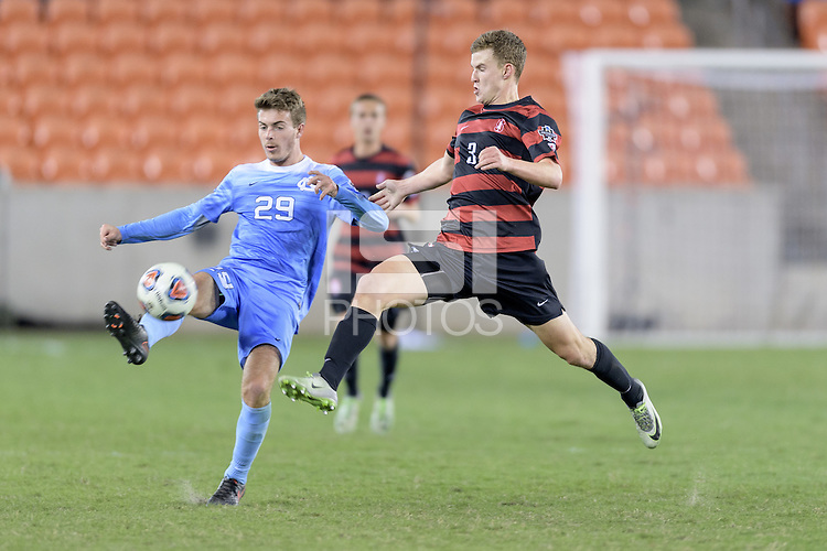 Houston, TX - Friday December 9, 2016: Tanner Beason (3) of the Stanford Cardinal attempts to block a kick by Jeremy Kelly (29) of the North Carolina Tar Heels at the NCAA Men's Soccer Semifinals at BBVA Compass Stadium in Houston Texas.