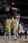 Doral Moore (4) of the Wake Forest Demon Deacons shoots over several Georgia Tech Yellow Jackets players during first half action at the LJVM Coliseum on February 14, 2018 in Winston-Salem, North Carolina.  The Demon Deacons defeated the Yellow Jackets 79-62.  (Brian Westerholt/Sports On Film)