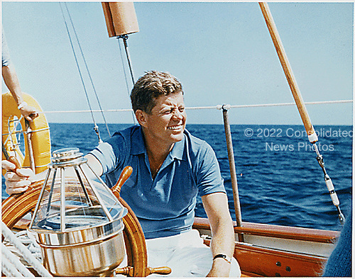 Narragansett Bay, RI -- United States President John F. Kennedy at the wheel of the Coast Guard Yacht &quot;Manitou&quot; on Narragansett Bay, RI on August 26, 1962<br />