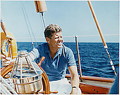 "Narragansett Bay, RI -- United States President John F. Kennedy at the wheel of the Coast Guard Yacht ""Manitou"" on Narragansett Bay, RI on August 26, 1962<br />