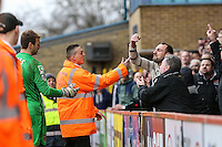 Northampton Town fans gesture at Jamie Jones of Stevenage as he goes to retrieve the ball during the Sky Bet League 2 match between Stevenage and Northampton Town at the Lamex Stadium, Stevenage, England on 19 March 2016. Photo by David Horn / PRiME Media Images.
