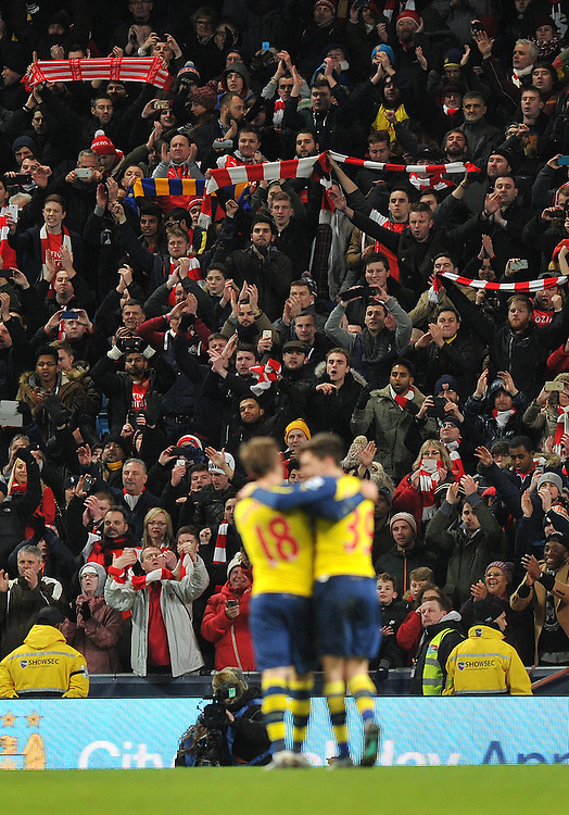The Arsenal fans celebrate at the final whistle <br /> <br /> Photographer Dave Howarth/CameraSport<br /> <br /> Football - Barclays Premiership - Manchester City v Arsenal - Sunday 18th January 2015 - Etihad stadium - Manchester<br /> <br /> &copy; CameraSport - 43 Linden Ave. Countesthorpe. Leicester. England. LE8 5PG - Tel: +44 (0) 116 277 4147 - admin@camerasport.com - www.camerasport.com
