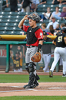 Albuquerque Isotopes catcher Dustin Garneau (13) during the game against the Salt Lake Bees in Pacific Coast League action at Smith's Ballpark on August 30, 2016 in Salt Lake City, Utah. The Bees defeated the Isotopes 3-2. (Stephen Smith/Four Seam Images)