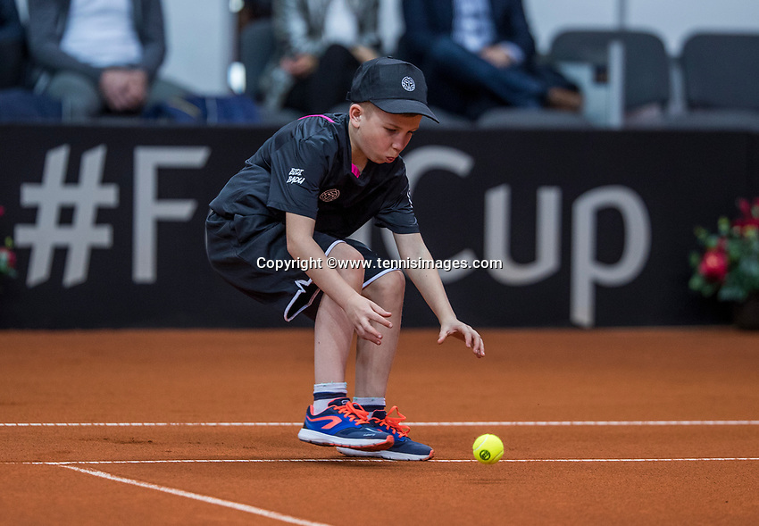 Bratislava, Slovenia, April 22, 2017,  FedCup: Slovakia-Netherlands, First rubber : ballboy in action<br /> Photo: Tennisimages/Henk Koster