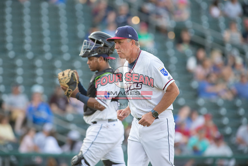 Northwest Arkansas Naturals pitching coach Doug Henry (19) jogs back to the dugout after making a visit to the mound during a Texas League game between the Northwest Arkansas Naturals and the Arkansas Travelers on May 30, 2019 at Arvest Ballpark in Springdale, Arkansas. (Jason Ivester/Four Seam Images)