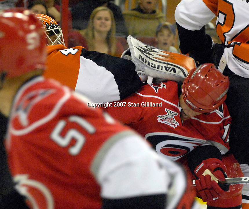 The Carolina Hurricanes' Eric Staal (12) collides with the Philadelphia Flyers' goalie Martin Biron during their game Wednesday, Nov. 21, 2007 in Raleigh, NC. The Flyers won 6-3.