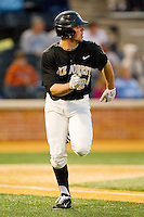 Charlie Morgan (24) of the Wake Forest Demon Deacons hustles down the first base line against the North Carolina Tar Heels at Wake Forest Baseball Park on March 9, 2013 in Winston-Salem, North Carolina.  The Tar Heels defeated the Demon Deacons 20-6.  (Brian Westerholt/Four Seam Images)