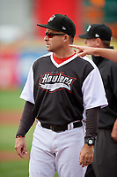 Erie SeaWolves coach Mike Rabelo (58) during the lineup exchange before an Eastern League game against the Portland Sea Dogs on June 17, 2019 at UPMC Park in Erie, Pennsylvania.  Portland defeated Erie 6-3.  (Mike Janes/Four Seam Images)