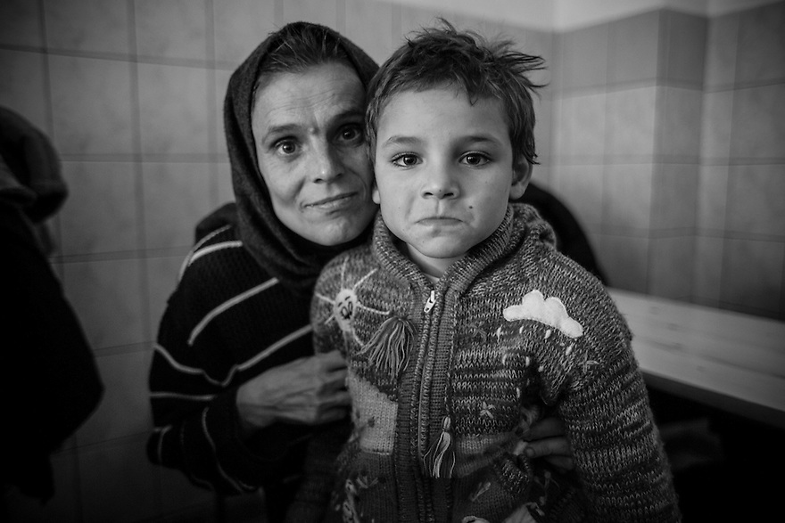 A mother and son sheltering at Victory Outreach, an evangelical soup kitchen, church and center for the homeless in Bucharest.