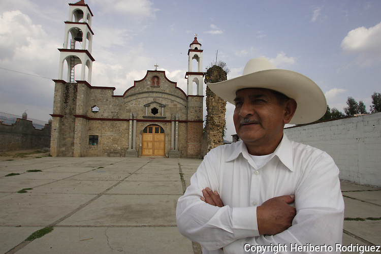 An old Mexican Native Nahnuh stands in front of an old church mixed with different architectonic styles in Jiquipilco El Viejo, in western Mexico state, April 20, 2005. Photo by Heriberto Rodriguez