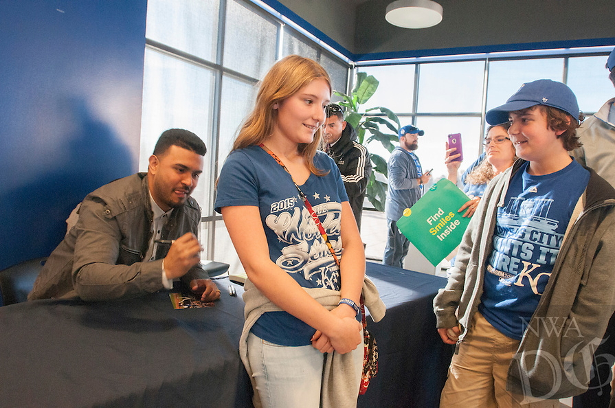 NWA Democrat-Gazette/ANTHONY REYES &bull; @NWATONYR<br /> Fans gather to take a photo with the 2015 World Series Trophy or get an autograph from Christian Colon Monday, Jan. 18, 2016 at Arvest Ballpark in Springdale. Colon was the Kansas City Royals infielder that hit the go ahead run in the World Series against the New York Mets.