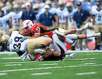 Navy's Alexander Teich is brought down by the Terrapins' defense. Maryland defeated Navy 17-14 at the M&T Bank in Baltimore, MD on Monday, September 6, 2010. Alan P. Santos/DC Sports Box