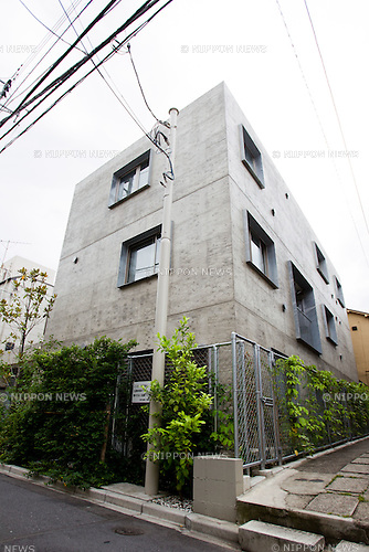 """June 21, 2012, Tokyo, Japan - A view of the """"Yotsuya Tenera"""" apartment building complex is shown in a residential area part of Tokyo. This Yotsuya Tenera building has been awarded for its distinct architecture based on its livability and design by the Royal Institute of British Architects (RIBA) on June 21, 2012. This three-story apartment complex located in a residential neighborhood in Tokyo highlights 12 unique types of accessible entrances into the building from two naturally lit and ventilated staircases eliminating the need for corridors. (Photo by Christopher Jue/AFLO)"""