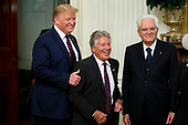 US President Donald J. Trump (L) poses for a picture with Italian-born American former racing driver Mario Andretti (C) and President of Italy Sergio Mattarella (R) during a reception in the East Room of the White House in Washington, DC, USA, 16 October 2019. US President Donald J. Trump hosted the President of Italy Sergio Mattarella and his daughter and Italy's First Lady Laura Mattarella at a reception held in honor of the Italian Republic.<br /> Credit: Michael Reynolds / CNP