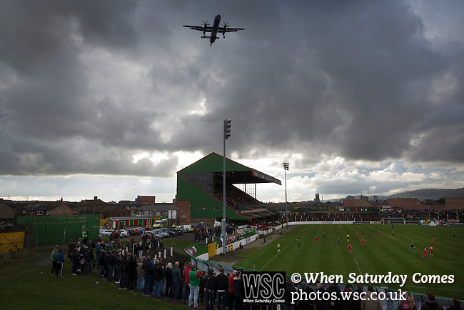 Glentoran 2 Cliftonville 1, 22/10/2016. The Oval, NIFL Premiership. An aircraft flies over The Oval, Belfast as Glentoran host city-rivals Cliftonville in an NIFL Premiership match. Glentoran, formed in 1892, have been based at The Oval since their formation and are historically one of Northern Ireland's 'big two' football clubs. They had an unprecendentally bad start to the 2016-17 league campaign, but came from behind to win this fixture 2-1, watched by a crowd of 1872. Photo by Colin McPherson.