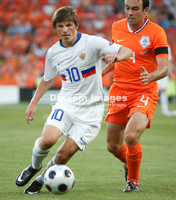 BASEL, SWITZERLAND - JUNE 21:    Andrei Arshavin of Russia (10) dribbles the ball as Joris Mathijsen of the Netherlands (4) defends during a UEFA Euro 2008 quarterfinal match at St. Jakob Park June 21, 2008 in Basel, Switzerland.  (Photograph by Jonathan P. Larsen)