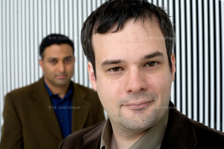 Dr. Andreas Velten, Postdoctoral Associate, (right) and Dr. Ramesh Raskar pose in the MIT Media Lab, where they work as part of the Media Lab Camera Culture group, at MIT in Cambridge, Massachusetts, USA.  Velten and Raskar's group has developed a camera that records at 1 trillion frames per second, which allows, for example, the recording of pulses of light moving through a liquid.