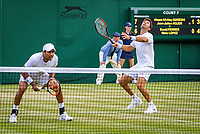 London, England, 4 th. July, 2018, Tennis,  Wimbledon, Men's doubles: Jean-Julian Rojer (NED) and Aisam-Ul-Hag Quershi (PAK) (L)<br /> Photo: Henk Koster/tennisimages.com