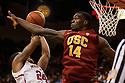 December 3, 2012: Dewayne Dedmon (14) of the USC Trojans fouls Dylan Talley (24) of the Nebraska Cornhuskers at the Devaney Sports Center in Lincoln, Nebraska. Nebraska defeated USC 63 to 51.
