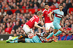 West Ham's Michail Antonio tackles Bastian Schweinsteiger of Manchester United during the Emirates FA Cup match at Old Trafford. Photo credit should read: Philip Oldham/Sportimage