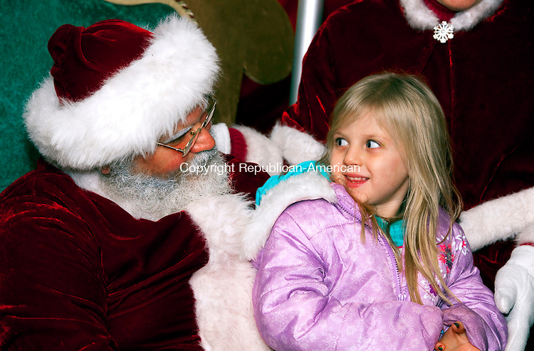 THOMASTON, CT--- -112815JS10--Alaysia Mott, 4, of Watertown tells Santa what she wants for Christmas during the annual Light Up Thomaston event Saturday in downtown Thomaston. <br /> Jim Shannon Republican-American