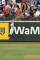 July 23, 2008: Seattle Mariners' Ichiro Suzuki makes a leaping catch against the right field wall during a game against the Boston Red Sox at Safeco Field in Seattle, Washington.