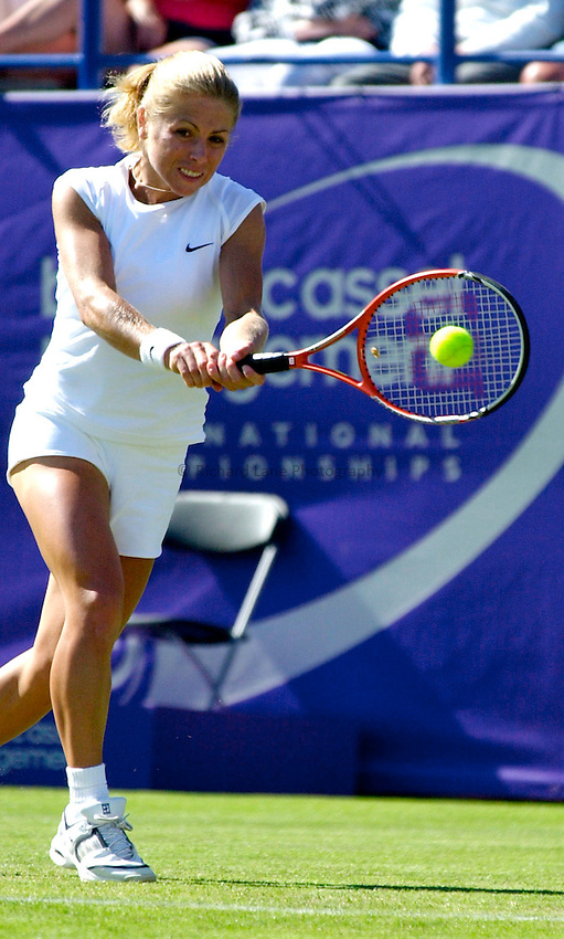 Photo. Rene Solari..20/6/01  .Eastbourne Tennis Day 3.  South African Amanda Coetzer struggles against American Lisa Ramond....