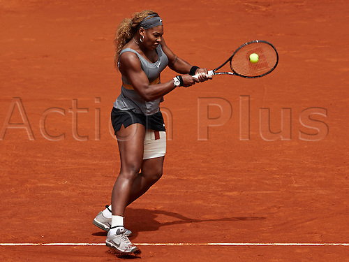 07.05.2014 Madrid, Spain. Serena Williams of USA plays a double handed backhand during the game with Shuai Peng of China on day 4 of the Madrid Open from La Caja Magica.