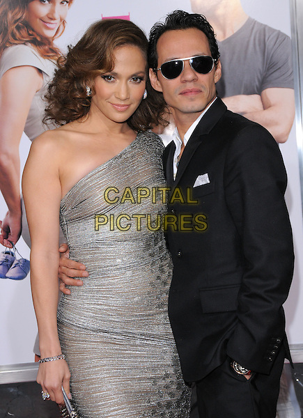 "JENNIFER LOPEZ & MARC ANTHONY .at the CBS Films' L.A. Premiere of ""The Back-Up Plan"" held at The Village Theatre in Westwood, California, USA, April 21st, 2010..arrivals half length sleeve one shoulder silver sheer shimmery shiny dress clutch bag  black suit married couple husband wife sunglasses arm around bracelet .CAP/RKE/DVS.©DVS/RockinExposures/Capital Pictures."
