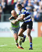 Aled Brew of Bath Rugby fends Nili Latu of Newcastle Falcons. Aviva Premiership match, between Bath Rugby and Newcastle Falcons on September 23, 2017 at the Recreation Ground in Bath, England. Photo by: Patrick Khachfe / Onside Images