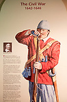 Display board picture of Civil War soldier 1642-1646 with permission of Chippenham museum, Wiltshire, England, UK loading musket with gunpowder