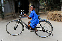 BANGLADESH Madhupur, Garo boy with bicycle, Garos is a ethnic and christian religious minority / Bangladesch, Region Madhupur, Garo Junge mit Fahrrad, Garos sind eine christliche u. ethnische Minderheit /