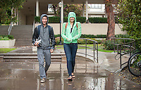 William Huang '15 and Emma Huang '16 (no relation) walk to the library in the rain, Feb. 28, 2014. (Photo by Marc Campos, Occidental College Photographer)