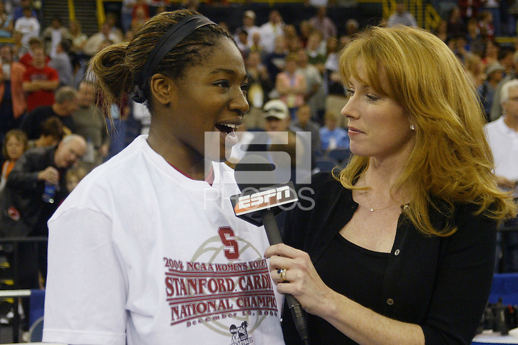 18 December 2004: Stanford Cardinal Ogonna Nnamani addresses the ESPN media during Stanford's  30-23, 30-27, 30-21 victory over Minnesota in the 2004 NCAA Women's Volleyball National Championships in Long Beach, CA. Stanford won their sixth women's volleyball title in school history. Nnamani was named the tournament's Most Outstanding Player and broke the tournament record for kills.<br />Photo credit mandatory: David Gonzales