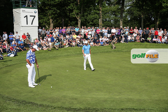 View of the 17th green as the last match of Scott Hend (AUS) and Danny Willett (ENG) get set to putt out during Round Three of the 2016 BMW PGA Championship over the West Course at Wentworth, Virginia Water, London. 28/05/2016. Picture: Golffile | David Lloyd. <br /> <br /> All photo usage must display a mandatory copyright credit to &copy; Golffile | David Lloyd.