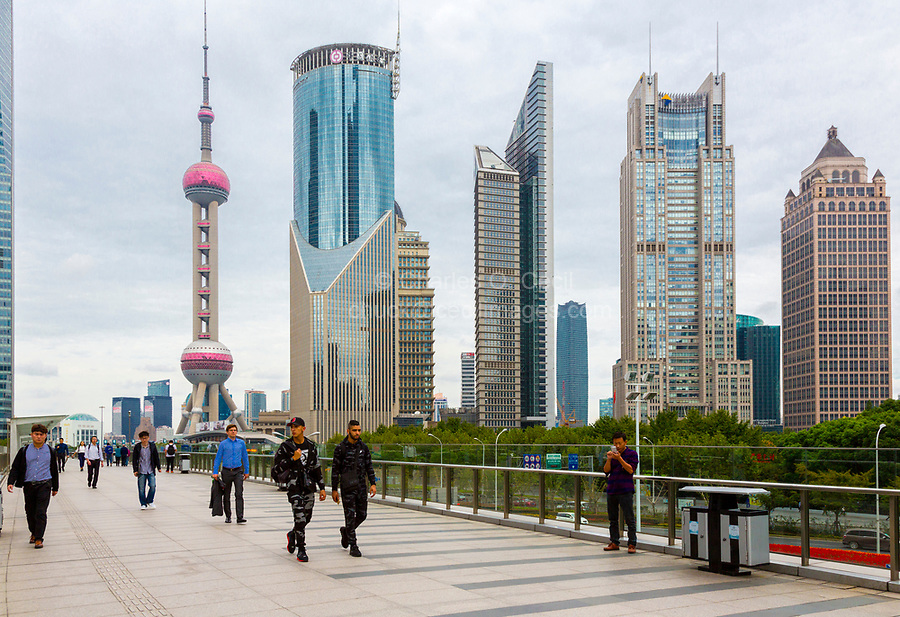 China, Shanghai.  Oriental Pearl TV Tower, Office Buildings, and Pedestrians.