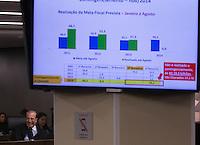 BRASILIA, DF, 07.10.2015 - TCU-CONTAS -  O ministro relator da matéria, Augusto Nardes, lê seu voto, tendo acima gráfico com dados, durante sessão para análise das contas públicas do Governo da presidente Dilma Rousseff de 2014, nesta quarta-feira, 07.(Foto:Ed Ferreira / Brazil Photo Press)