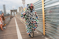 Brooklyn, NY -  3 September 2010 Environmental Activist, the Can Man, joins unicyclists riding across the Brooklyn Bridge enroute to Coney Island, during the Brooklyn Long Distance Unicycle Ride.