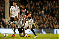 Richard Stearman of Sheffield United stops Denis Odoi of Fulham FC during the Sky Bet Championship match between Fulham and Sheff United at Craven Cottage, London, England on 6 March 2018. Photo by Carlton Myrie.