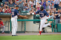 Rochester Red Wings designated hitter Kennys Vargas (30) is congratulated by manager Joel Skinner (35) as he rounds third base after hitting a home run in the bottom of the fourth inning during a game against the Pawtucket Red Sox on July 4, 2018 at Frontier Field in Rochester, New York.  Pawtucket defeated Rochester 6-5.  (Mike Janes/Four Seam Images)