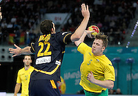 Spain's Angel Montoro Cabello (l) and Australia's Tommy Fletcher during 23rd Men's Handball World Championship preliminary round match.January 15,2013. (ALTERPHOTOS/Acero) /NortePhoto
