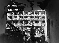 Four Vietnamese and three Americans were killed, and dozens of Vietnamese buildings were heavily damaged during a Viet Cong bomb attack against a multi-story U.S. officers billet in Saigon.  April 1, 1966.  JUSPAO.  (USIA)<br /> NARA FILE #:  306-MVP-5-3<br /> WAR &amp; CONFLICT BOOK #:  420