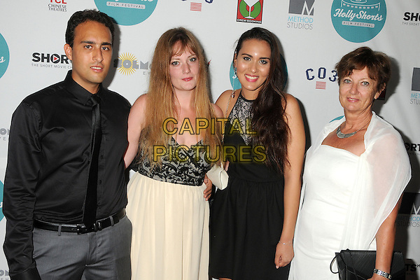 14 August 2014 - Hollywood, California - Youcef Mahmoudi, July Allard, Fatima Mahmoudi, Florence Leu. 10th Annual HollyShorts Film Festival Opening Night Celebration held at the TCL Chinese Theater.  <br /> CAP/ADM/BP<br /> &copy;Byron Purvis/AdMedia/Capital Pictures