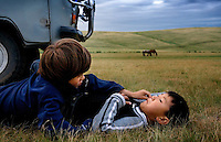 "Rowan, a five-year-old autistic child, communicates with six-year-old Bodibilguunson, the son of a guide, during a horseback expedition across Mongolia. Rowan, who has been nicknamed ""The Horse Boy"", embarked on a therapeutic journey of discovery with his parents to visit a succession of shaman healers in one of the most remote regions in the world. Following Rowan's positive response to a neighbour's horse, Betsy, and some reaction to treatment by healers, Rowan's parents hoped that the Mongolian shamanistic rituals along the route and the prolonged contact with horses would help to unlock their son's autism and assist his development.."