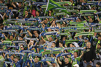 Fans of the Seattle Sounders FC hold up scarfs. The Seattle Sounders FC defeated the Columbus Crew 2-1 during the US Open Cup Final at Qwest Field in Seattle,WA, on October 5, 2010.