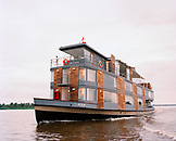 PERU, Amazon Rainforest, South America, Latin America, the MV Aqua, a luxury cruised boat, crusing along the Amazon River.