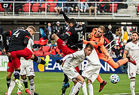 WASHINGTON, DC - FEBRUARY 29: Russell Canouse #4 of DC United heads down the ball for a D.C United goal during a game between Colorado Rapids and D.C. United at Audi Field on February 29, 2020 in Washington, DC.